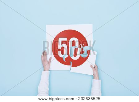 Woman Completing A Puzzle With A 50% Off Discount Icon