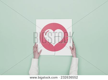 Woman Completing A Puzzle With Heart Icon