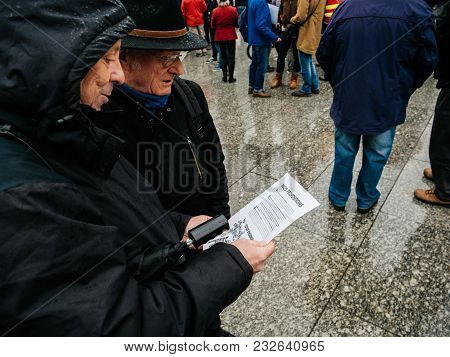 Strasbourg, France  - Mar 22, 2018: Senior Couple Reading Manifest Flyer At Demonstration Protest Ag