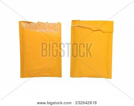 Two Opened Yellow Online Shopping Packing Envelopes With Bubble Wrap Inside Isolated On White