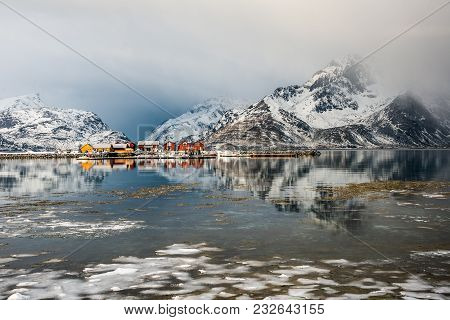Scenery With Reflected Cottages In Lofoten, Norway Before Snow Storm