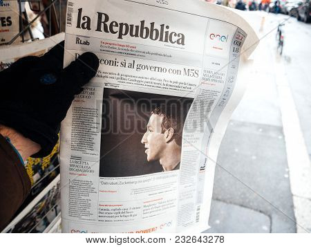 Strasbourg, France  - Mar 22, 2018: Man Reading Buying Italian La Republica Newspaper At Press Kiosk