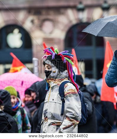 Strasbourg, France  - Mar 22, 2018: Young Boy With Funny Hat And Mask At Demonstration Protest Strik