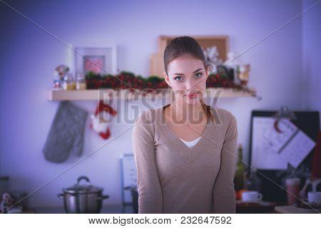 Smiling Attractive Woman Having Breakfast In Kitchen Interior.smiling Attractive Woman