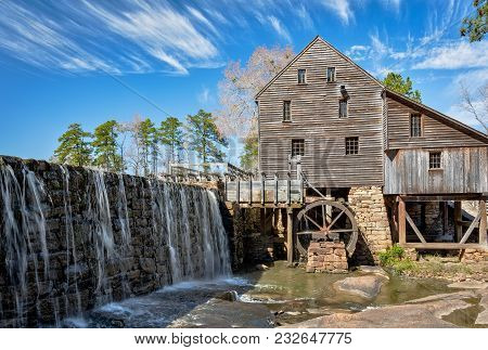 Old Rustic Mill In North Carolina With Waterfall In Foreground And Tall Pine Trees, Mill And Mill Wh