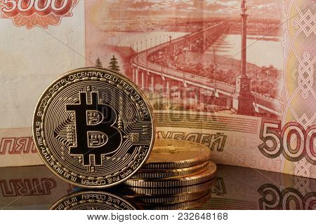 Golden bitcoins and ruble banknote. Concept of trading cryptocurrency. Business concept. Exchange bitcoin.