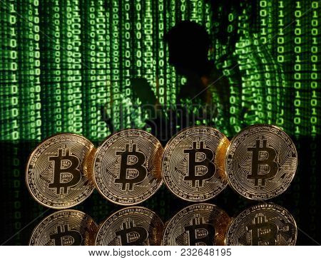 Cryptocurrency in front of green matrix background.