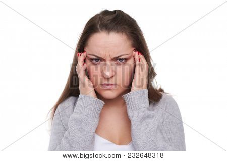 woman with migraine looking at camera