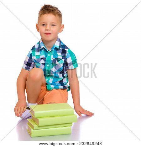 A Cute Little Boy, A Preschooler With Books. The Concept Of Education, The Intellectual Development