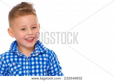 A Beautiful Little Boy Laughs Fun. The Concept Of A Happy Childhood, Well-being And Family Values. I