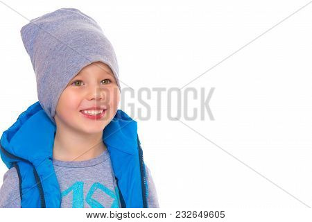 A Little Boy In A Jacket And Hat.