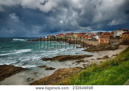 Ocean coast in the north west of Spain, Galicia region, little town of Caion, beaches and cliffs