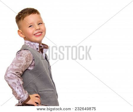 Smiling Little Boy, Studio Portrait On White Background. The Concept Of A Happy Childhood, Well-bein