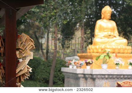 Wooden Wish Board Near Golden Buddha Statue