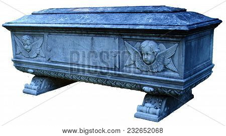A Tombstone Shaped Like A Coffin With Cherubs And Ornate Design Isolated.