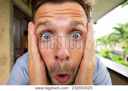 Panic Man Is Shocked. His Face Is Close To Camera. He Is Opening His Mouth In Surprise. Concept Of R