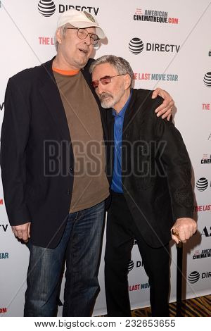 LOS ANGELES - FEB 22:  Chevy Chase, Burt Reynolds at the