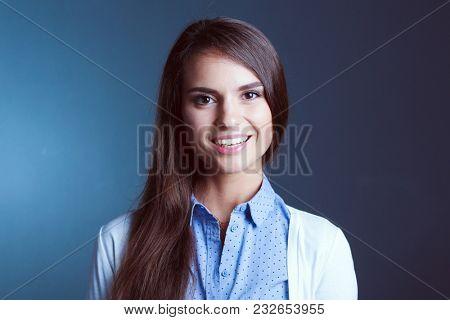 Portrait of a businesswoman , against dark background
