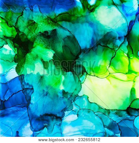 Blue And Green Flowy Alcohol Inks In Abstract Design.