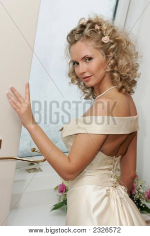 Bride With Bouquet Stood Near Window