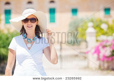 Beautiful young woman summer in hat