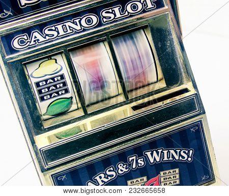 retro toy slot machine spinning to win.
