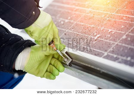 Electricity Technician Installing Blue Solar Panels With Screw. Photovoltaic Modules As Renewable En