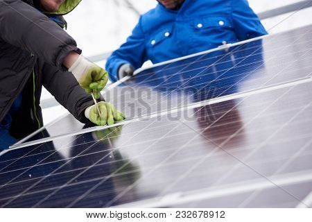 Cropped Shot Of Professional Electricians Working On Solar Power Plant Factory Renewable Energy Elec