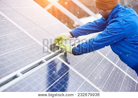 Male Electrician Worker Repairing Solar Panels Outdoors Alternative Energy Source Environment Friend