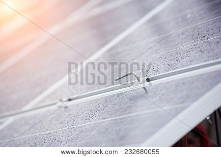Close Up Of Screw And Blue Solar Panels Photovoltaic Modules For Alternative Renewable Energy Power