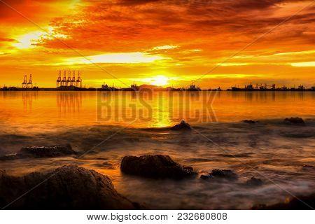 Landscape Sea Around Corgo Container Yard Port At Twilight Sky.