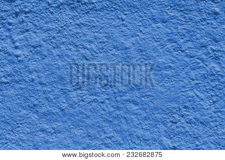 Background Sheeting Wall Of A Building - (plaster). Toning In Pantone Color Marina.