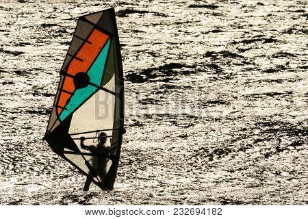 Les Arqueirons, France, Jan. 30, 2015 Windsurfer In The Evening Sun In The Camargue