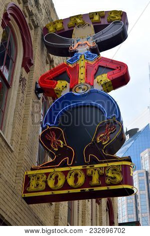 Nashville, Tennessee, Usa - March 19, 2018: Hats And Boots Neon Sign At Lower Broadway Area Advertis