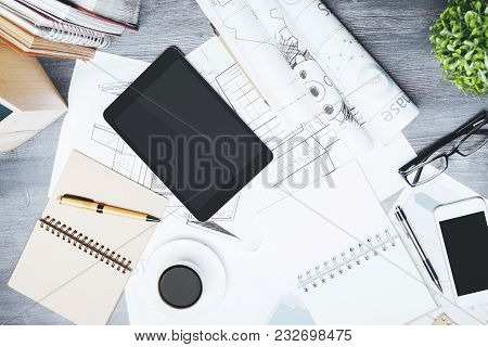 Blank Touchpad And Smartphone Place On Modern Office Table Top With Supplies And Other Items. Mock U