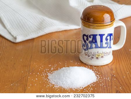 Ceramic Retro Salt Shaker On Rustic Wooden Kitchen Table With Heap Of Salt Crystals - Kitchen Backgr