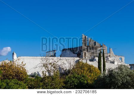 Crato Castle ruins in Crato, Portugal. Destroyed in battle. Belonged to the Hospitaller Crusader Knights aka Malta Order. Being rebuilt by a private with scaffolding and concrete structures visible