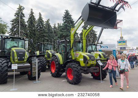 Ukraine, Kiev - June 10, 2016: Visitors Near The Exhibits International Agro-industrial Exhibition