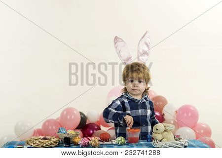 Easter Egg And Little Child. Funny Little Boy With Bunny Ears And Colorful Easter Eggs. Easter Holid