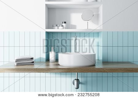 Round Sink In A Blue Tiled And White Bathroom Interior With Wide Toiletry Shelves Behind It. 3d Rend