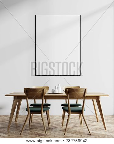 Modern Minimalistic Dining Room Interior With White Walls, A Wooden Floor And A Long Table With Chai