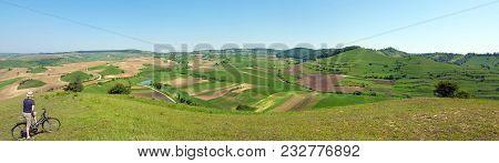 Biker Admiring Scenery Hills In Transylvania In Summer