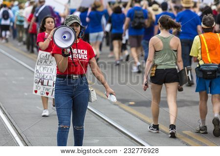 Tucson, Az - March: Unidentified Young Woman Directing Walkers At March For Our Lives Gun Violence P