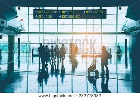 Silhouette Of Group Business People, Passenger, Traveler And Group Tourist Walking In An Internation