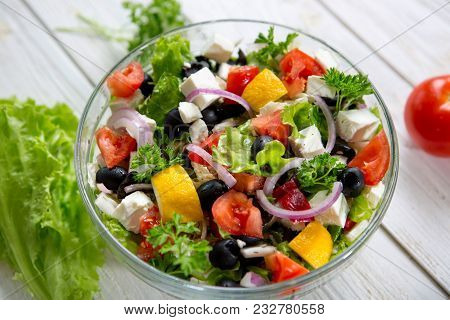 Fresh Vegetable Salad With Feta Cheese, Fresh Lettuce, Cherry Tomatoes, Red Onion And Pepper.