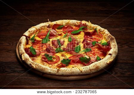 Delicious Italian Pizza Margherita With Tomatoes, Basil And Hamon Served On Wooden Plate Over Rustic