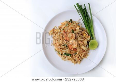Thai Style Noodles, Pad Thai, Stir-fried Rice Noodles With Shrimp Serve With Vegetable In White Plat