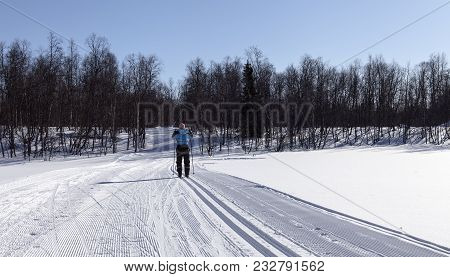 Hemavan, Sweden On March 15. View Of A Cross-country Track This Side A Forest And Mountains On March