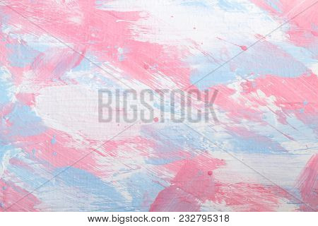 Background of putty painted in light blue, pink and white colors. Uneven texture. Abstract multicolored stains as wall pattern poster