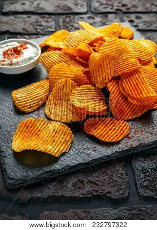 Potato Chips, Snack Crisps With Red Pepper And White Dip Sauce.